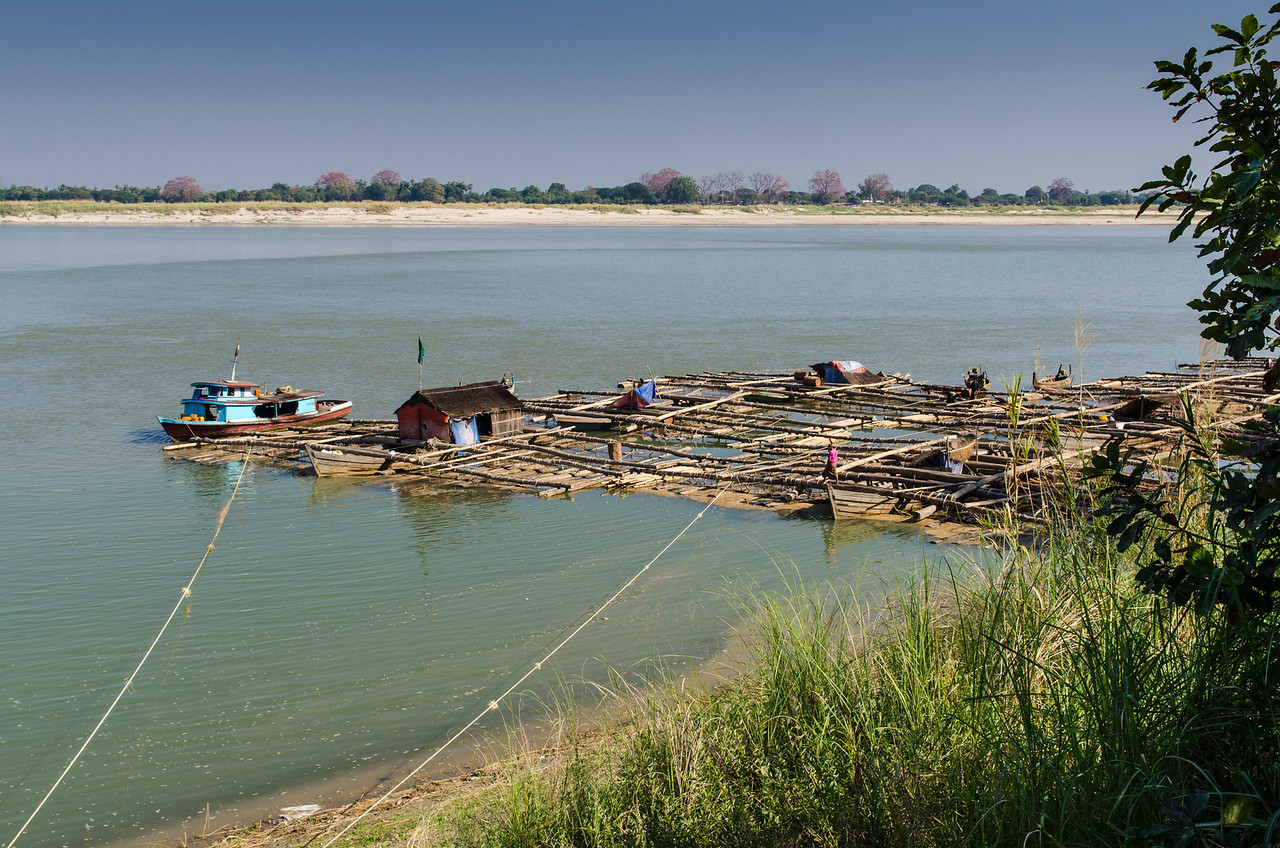 This bamboo raft on the Irrawaddy almost has a village on it.