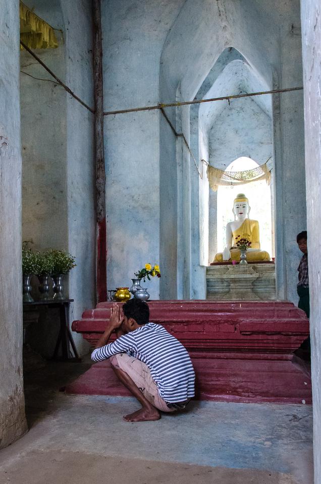 Man praying in the temple at Mingun.