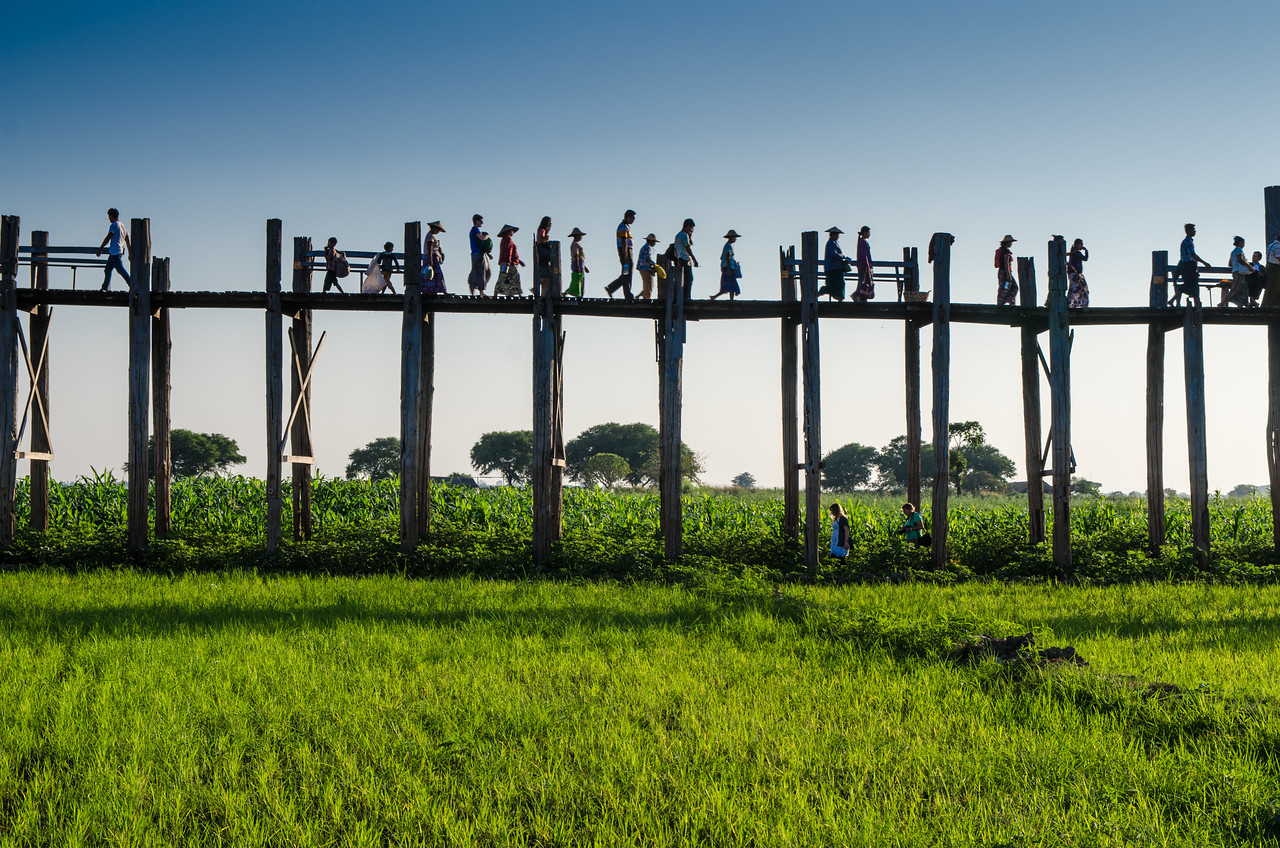 People passing back and forth on the U Bein Bridge.