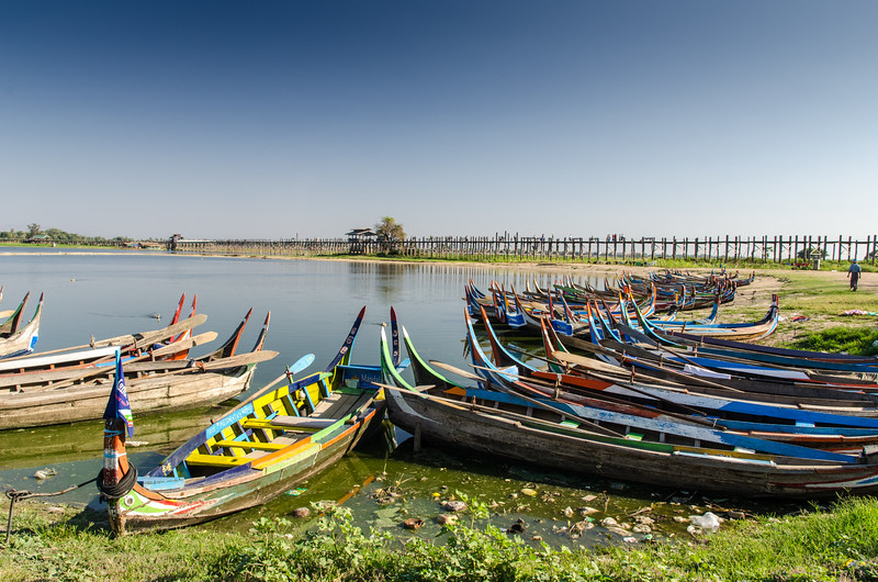 Tourist boats waiting for customers on the shore of Taung Tha Man Lake at U Bein Bridge.