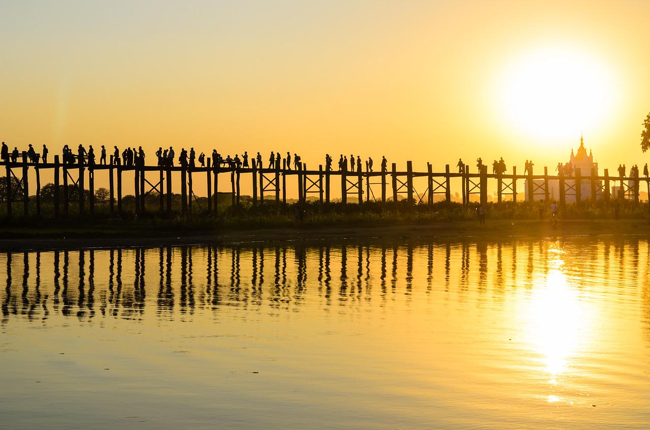 Sunset at U Bein Bridge with Shwe Modeptaw Pagoda.