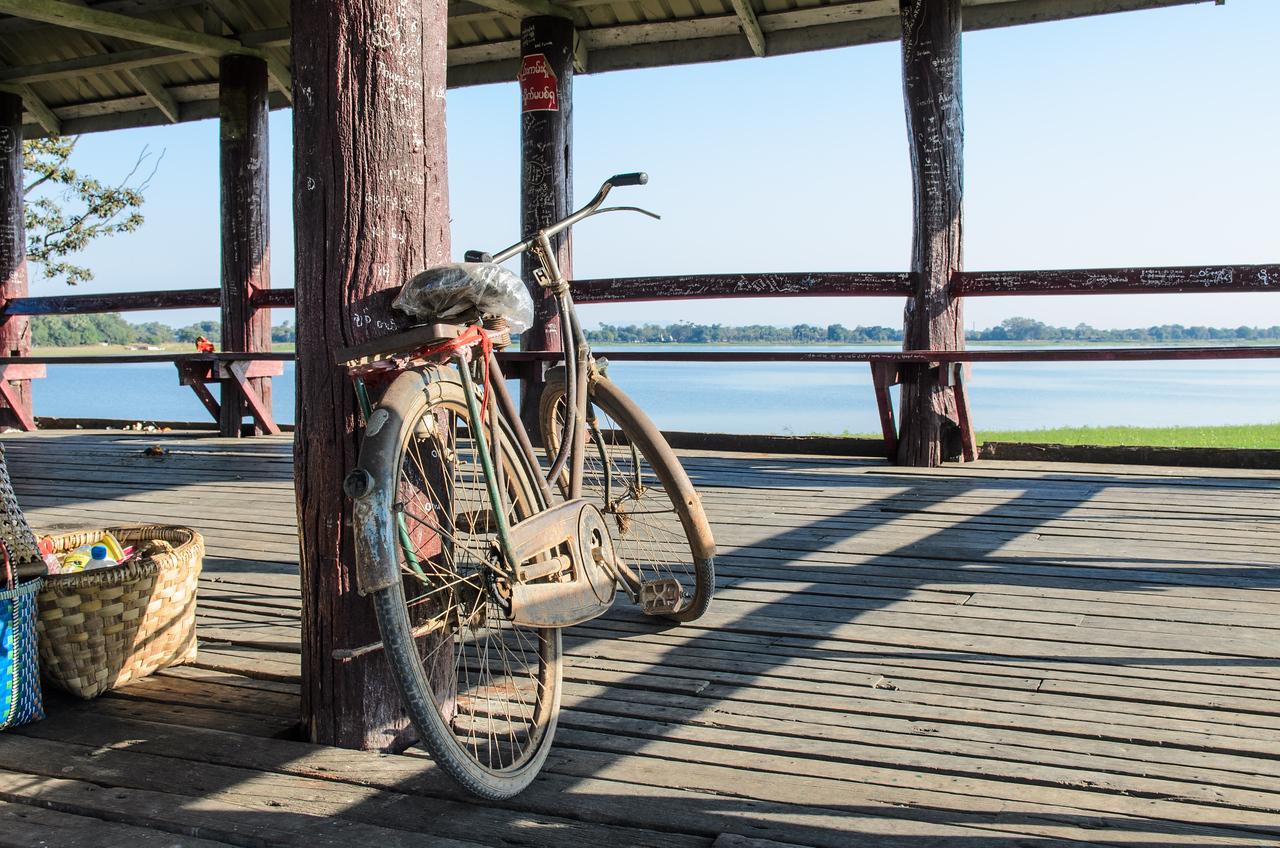 Old bike on the bridge.