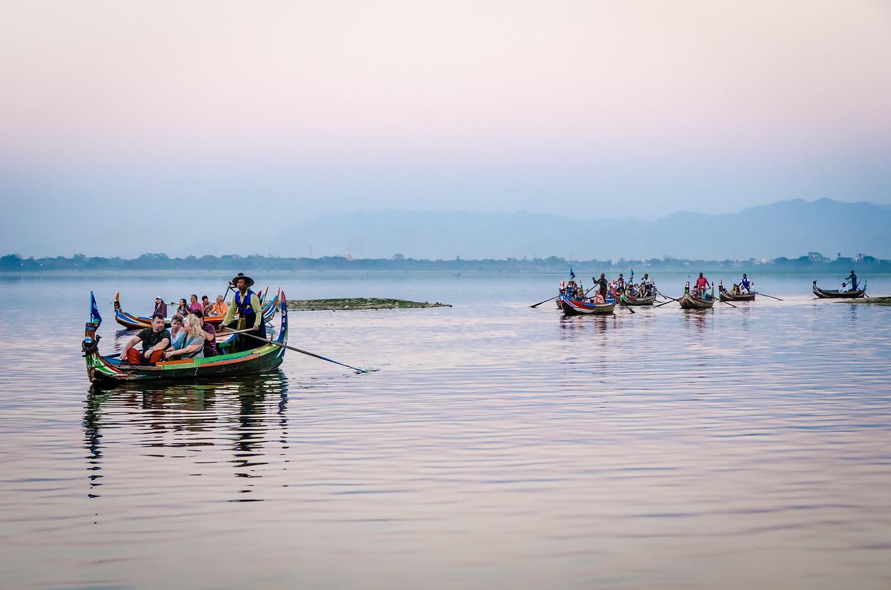 Twilight on Taung Tha Man Lake near U Bein Bridge with boats.