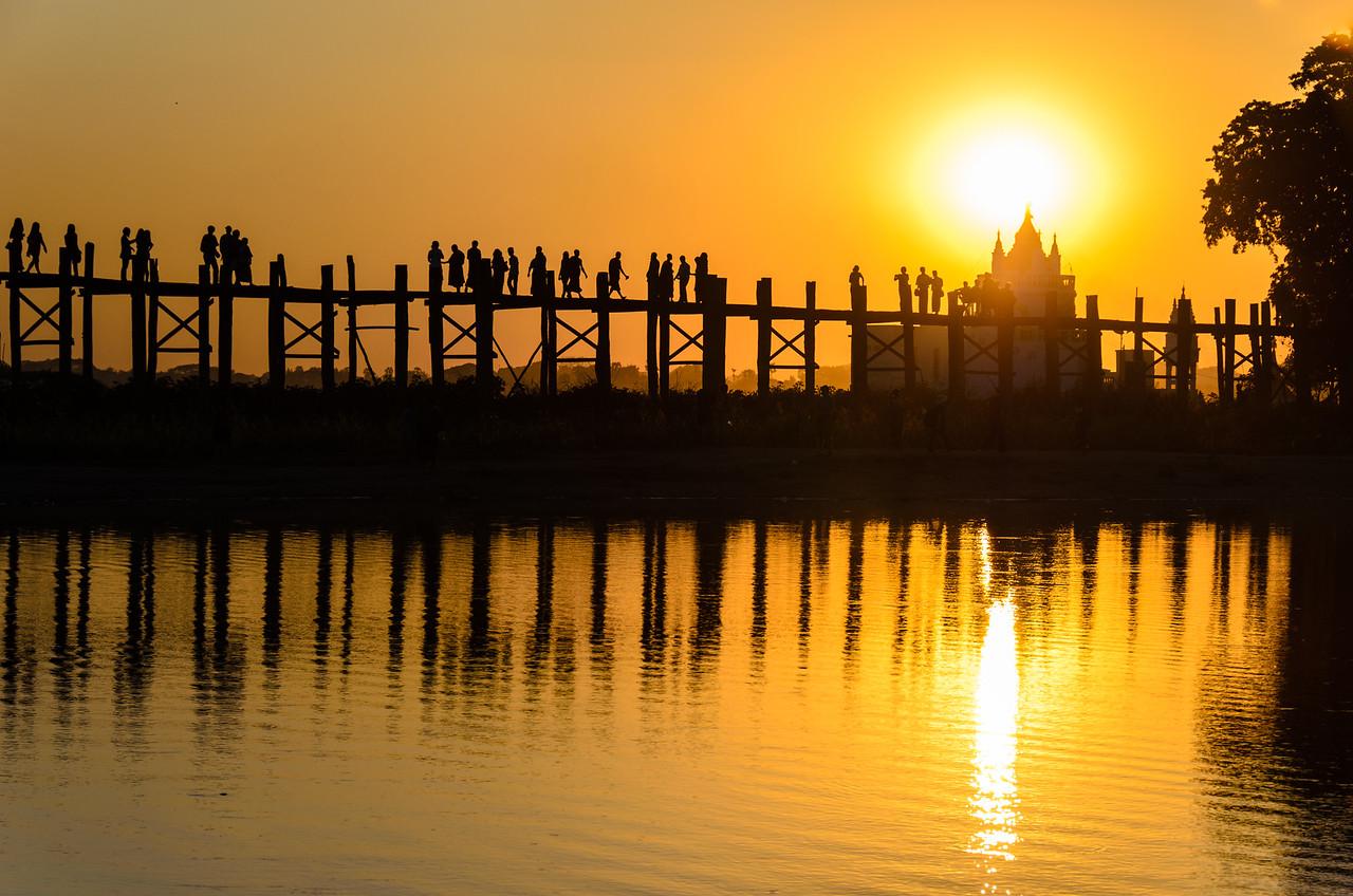 Sunset at U Bein Bridge with Shwe Modeptaw Pagoda..