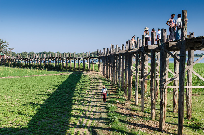 The bridge was built from wood reclaimed from the former royal palace in Inwa. It features 1,086 pillars that stretch out of the water, some of which have been replaced with concrete.
