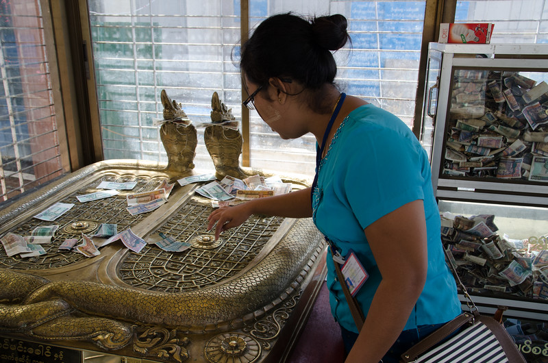 Our guide explains the Buddha's footprints.