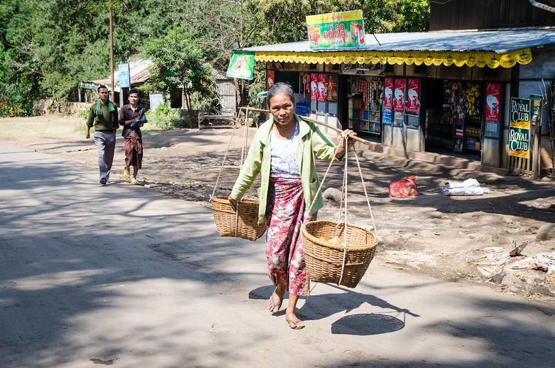 Lady with baskets, Popa Village.
