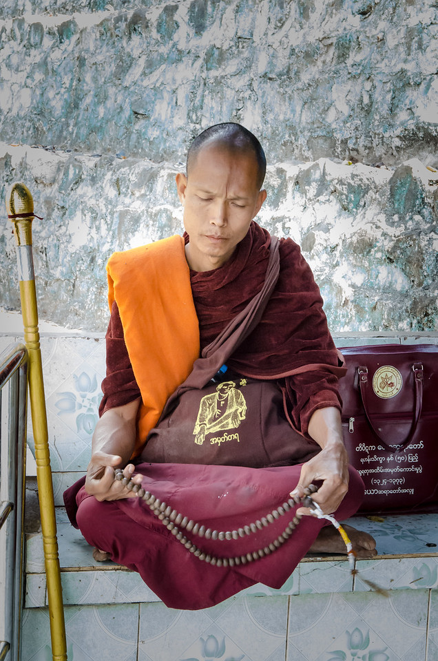 A monk prays at the Mt Popa shrine.
