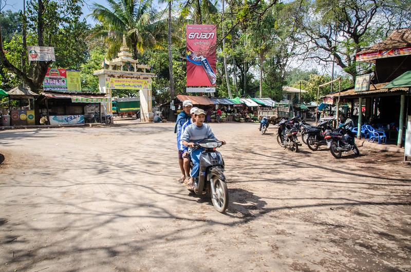 Kids on a scooter at Popa Village.