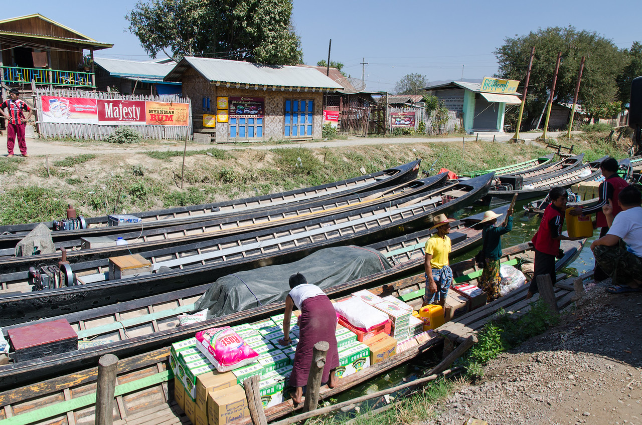Here a long boat is loaded with merchandise for delivery to villages on the lake.