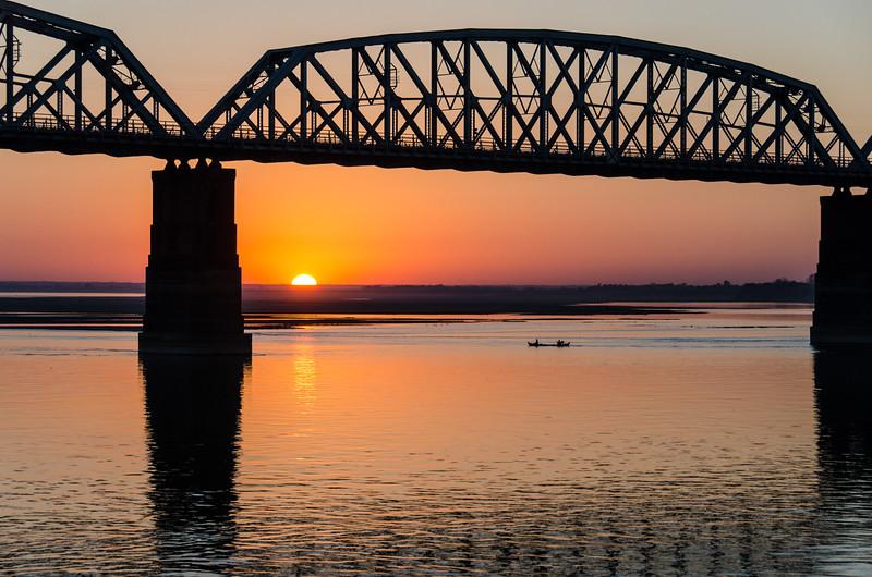 Sunset and the Inwa Bridge on the Irrawaddy.