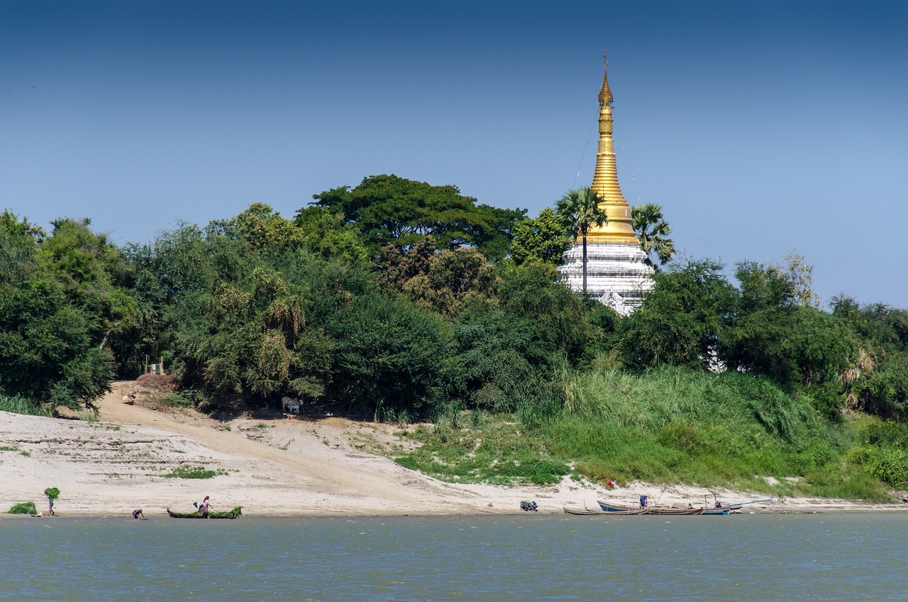 Golden stupa along the river.