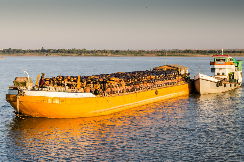 A barge full of pots headed to market.