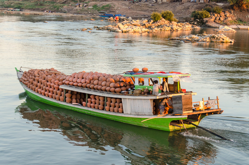 The boat is loaded with terra cotta water jugs.