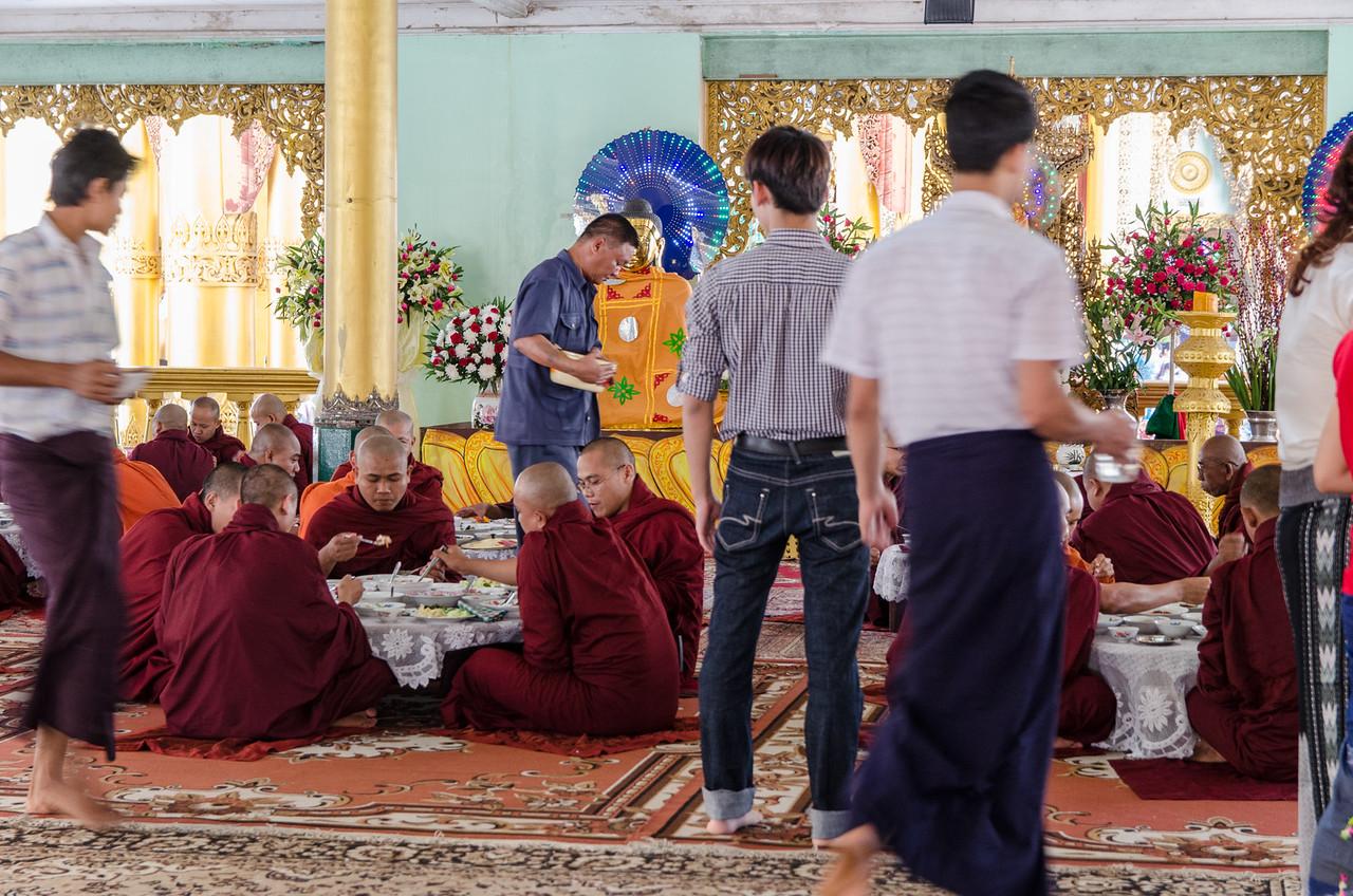Buddhist monks having lunch.