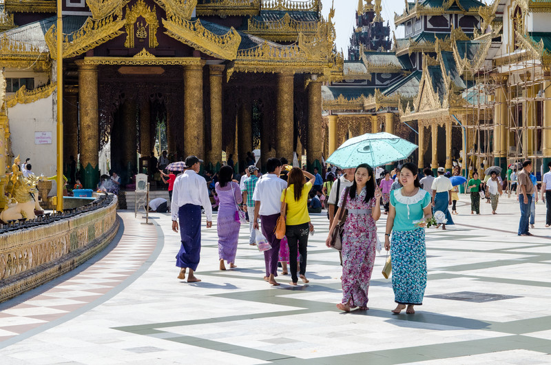 The pagodas, and especially Shwedagon, are big park-like complexes.  People go and just hang out with friends and family.
