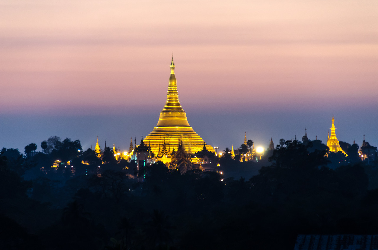 Shwedagon Pagoda at twilight as seen from the Green Hill Hotel.