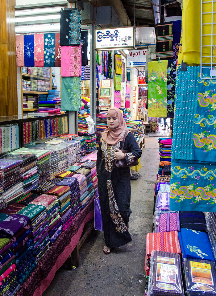 Woman shopping for cloth in the Bogyoke Aung San Market.