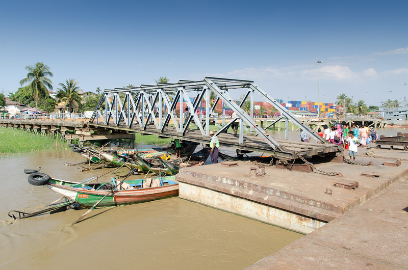 Water taxis wait to ferry people across the Yangon River.