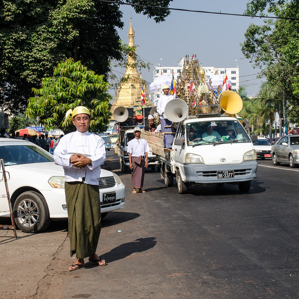 This procession was passing by on the street.