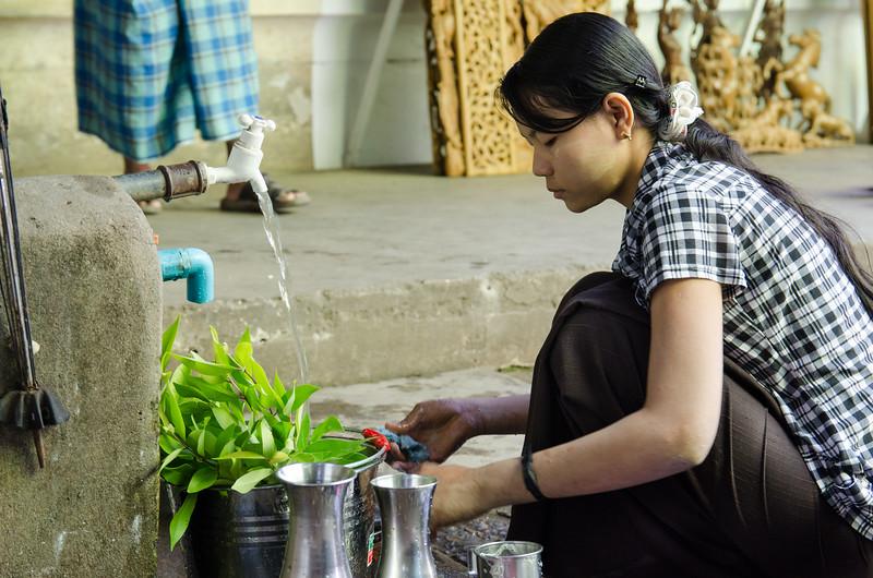 Woman washing produce.