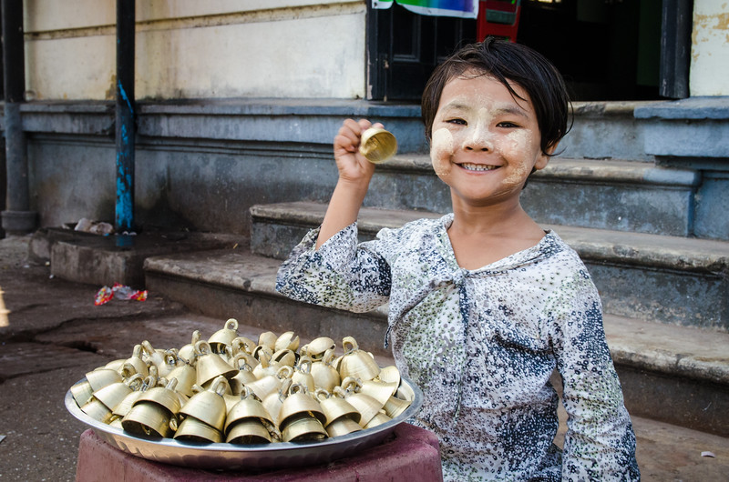 Little girl selling bells.