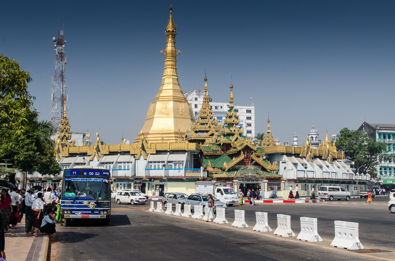 The Sula Pagoda sits in the middle of a busy traffic circle.