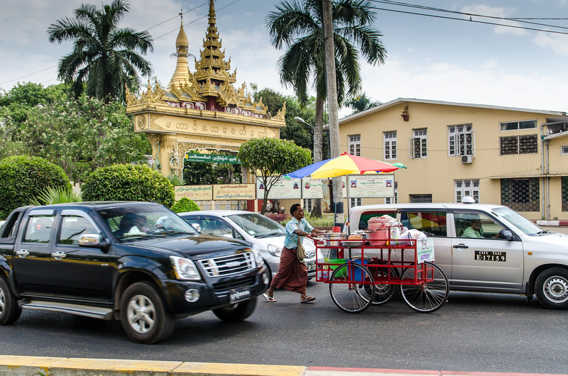 All kinds of vehicles mix it up on the streets of Yangon.