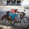 Napping trishaw driver.
