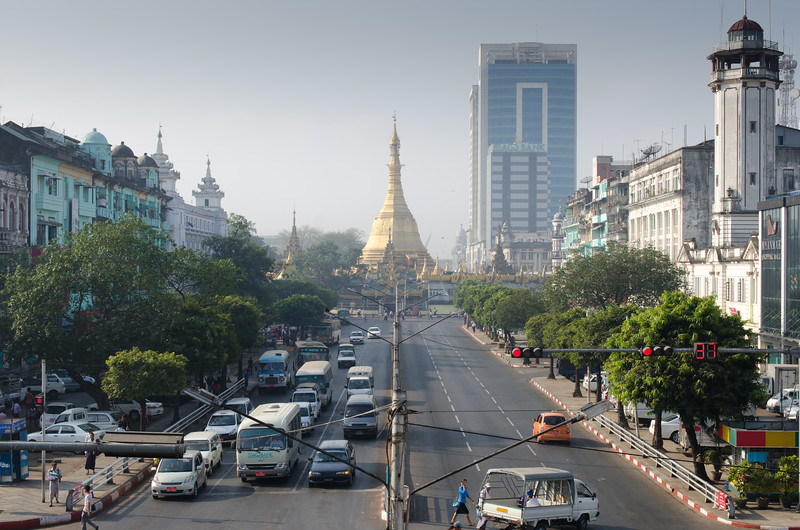 Yangon street scene with the Sule Pagoda in the distance.
