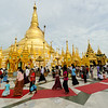 Worshippers walk around the Shwedagon Pagoda