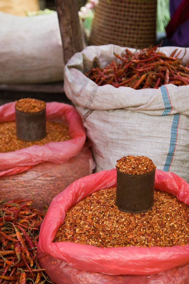 Sacks of peppers and pepper seeds at the weekly town market.  Just the thing to give your cooking a little 'kick'.<br /> <br /> Location: Nyaungshwe, Myanmar<br /> <br /> Lens used: 24-105mm f4.0 IS