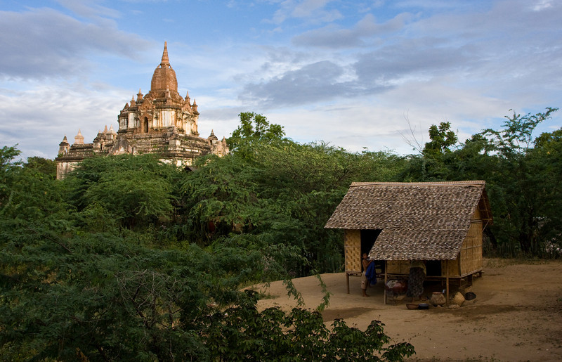 A simple, but well-tended family hut sits in the shadow of one of the numerous Bagan temples.<br /> <br /> Location: Nyaung U, Myanmar<br /> <br /> Lens used: 24-105mm f4.0 IS