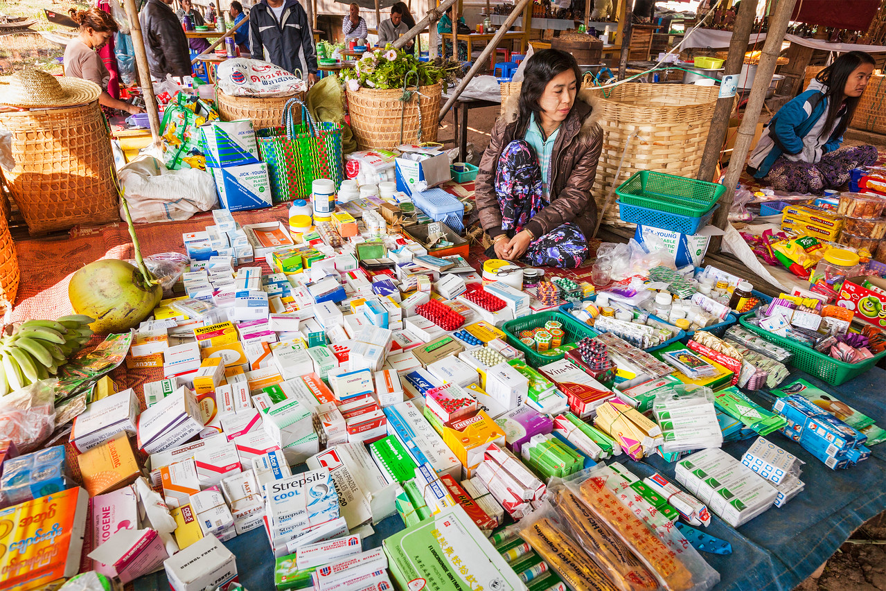 Woman selling medicines and drugs at rural market