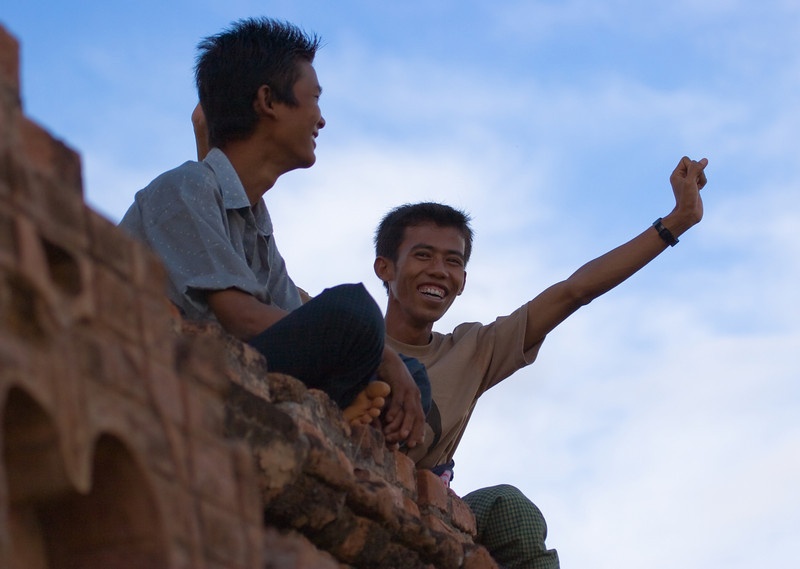 A couple of local young guys having a good time up on a temple at dusk.<br /> <br /> Location: Bagan, Myanmar<br /> <br /> Lens used: 100-400mm f4.5-5.6 IS
