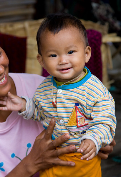 Parents love showing off their kids.<br /> <br /> Location: Nyaungshwe, Myanmar<br /> <br /> Lens used: 24-105mm f4.0 IS