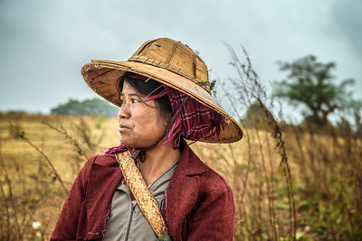 Portrait of a young female farmer working in a field