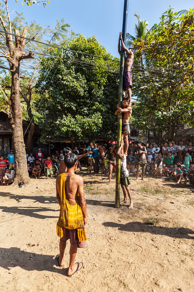 Greasy pole climbing competition in village on Myanmar independence day