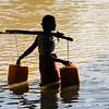 Village girl carries water