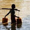Village girl carries water
