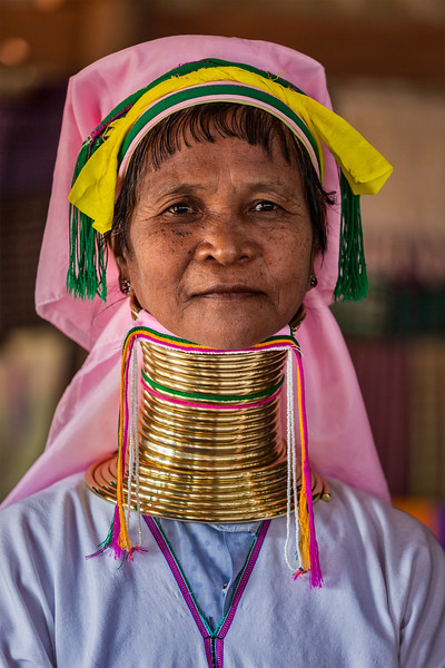 INLE LAKE, MYANMAR - JANUARY 7, 2014: Unidentified Padaung long-necked tribe woman. The Padaung long-necked tribe women wear brass rings around neck from 5 years old and minority of Myanmar exploited for tourism reasons