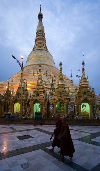 Two monks walk around the Shwedagon pagoda at dusk.<br /> <br /> Location: Yangon, Myanmar<br /> <br /> Lens used: 10-22mm f3.5-4.5