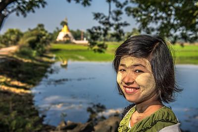 Portrait of a burmese girl with thanaka on her face