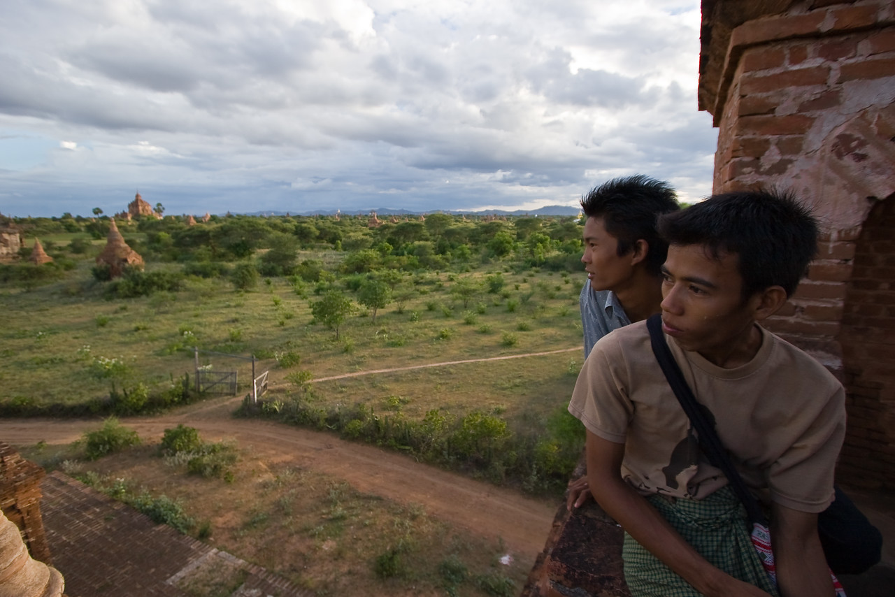 Though very few of the Bagan temples are venerated anymore, they're not completely ignored by the locals.  Like the foreign tourists that come here, the locals also enjoy climbing them and hanging out.  These young guys climbed the same temple I was enjoying this evening to work on their biology homework and later, as the sun started to set, admire the view.  <br /> <br /> They were cool and were willing to indulge me in my desire to get a good photo.  Here, they gave me a pretty 'natural-looking' pose of contemplating the view.  Thanks Guys!<br /> <br /> Location: Bagan, Myanmar<br /> <br /> Lens used: 10-22mm f3.5-4.5