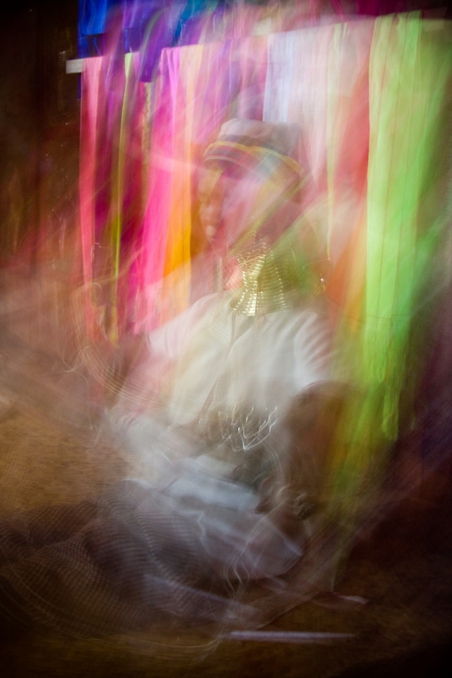 An abstract take on a 'Long-necked' woman sitting at a weaving loom in a craft shop.<br /> <br /> Location: Inle Lake, Myanmar<br /> <br /> Lens used: 24-105mm f4.0 IS