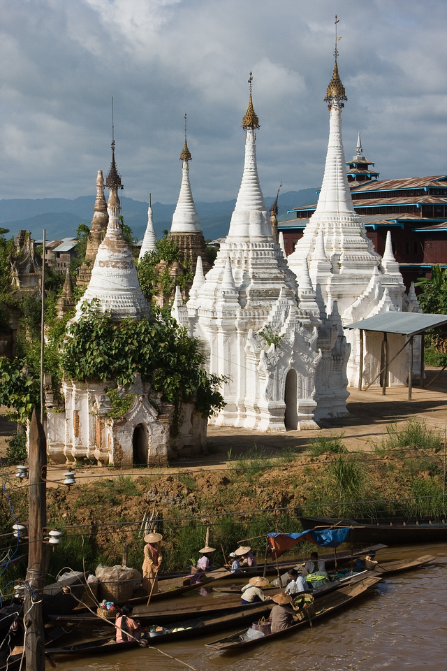 These aged white stupas provide a great backdrop to a canoe-based market on the water.<br /> <br /> Location: Inle Lake, Myanmar<br /> <br /> Lens used: 24-105mm f4.0 IS