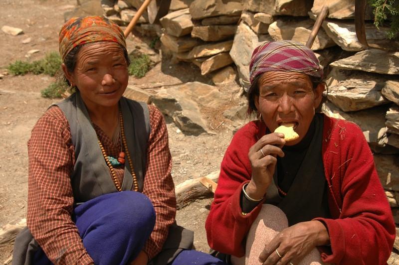 Nepali Women with Biscuits - Annapurna Circuit, Nepal
