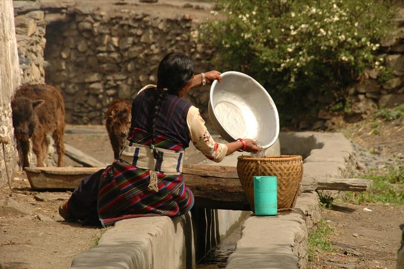 Nepali Woman with Water - Annapurna Circuit, Nepal