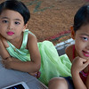 Girls watching a movie on their iPad infront of a Temple in Yangon, Myanmar