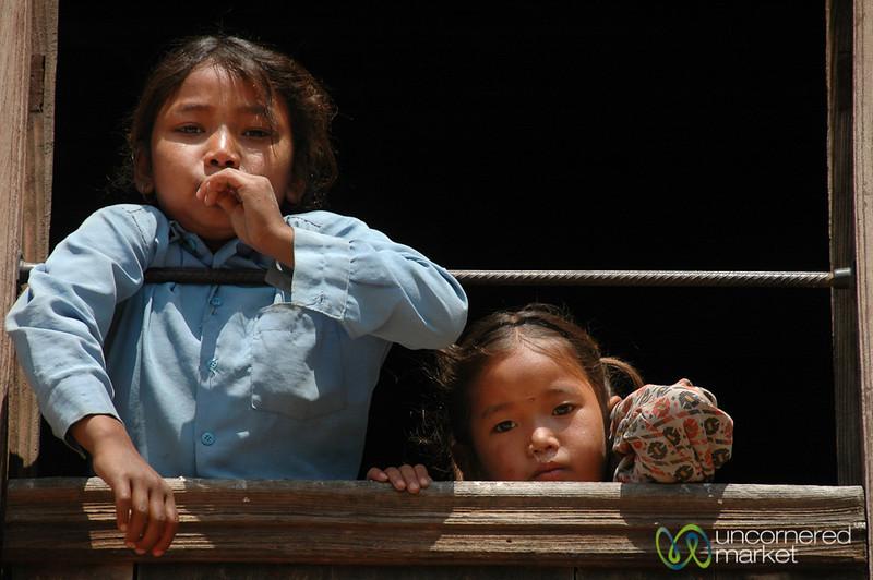 School Girls Peeking Out - Bakhtapur, Nepal